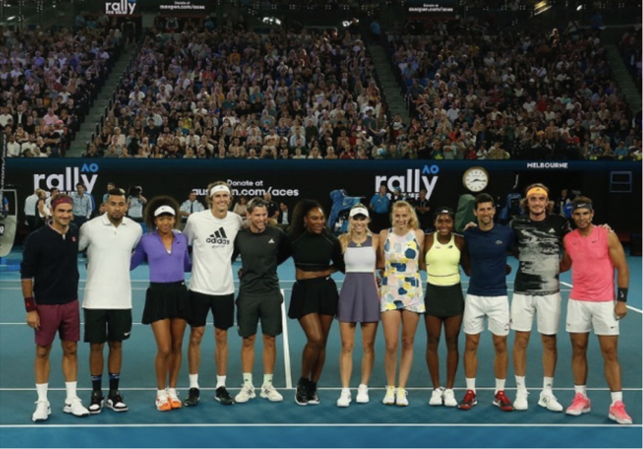 The+tennis+athletes+who+took+part+in+the+Rally+for+Relief+charity+match.+The+stadium+filled+by+tennis+enthusiasts.+Photo+courtesy+of+Google+Images.