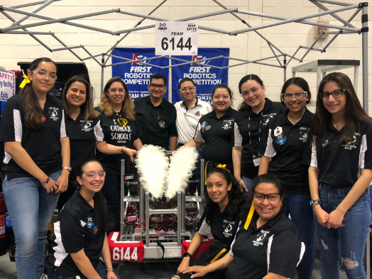 The robotics team poses for a photo at the El Paso FRC Competition, their first competition. Listed from left to right: Kaitlyn Horn, Mrs. Chavarria, Mrs. Harvey, Mr. Perez, Dr. Gonzalez, Snowbird Rubio, Bryanna Alcantar, Samantha Perez, Paulina Ponce, Bella Herrera, Anaissa Rodriguez, and Mrs. Gonzalez.