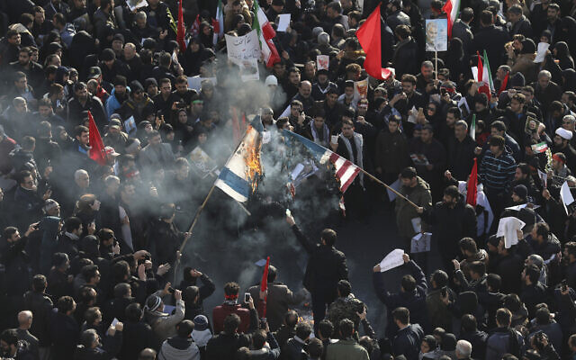 During+the+funeral+for+General+Qasem+Soleimani+in+the+capital+of+Israel%2C+mourners+burned+American+flags+and+chanted+%E2%80%9CDeath+to+America.%E2%80%9D+Soleimani%E2%80%99s+assassination+on+January+3+caused+a+breakdown+in+relations+between+America+and+Israel.+Photo+courtesy+of+%3Ci%3EThe+Times+of+Israel%3C%2Fi%3E.%0A