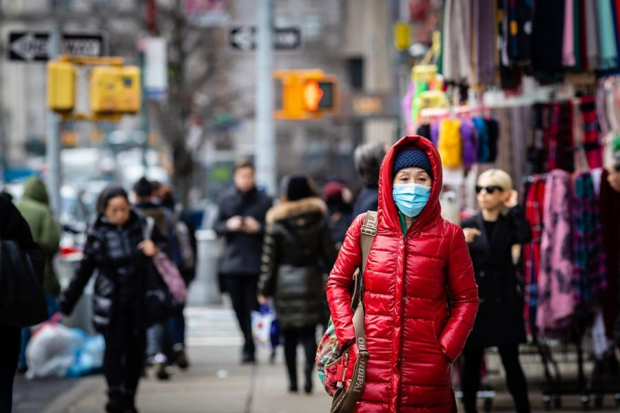 Woman+walking+around+the+streets+of+New+York.+She+is+wearing+a+mask+for+protection+against+the+coronavirus.+Photo+courtesy+of+the+New+York+Post.