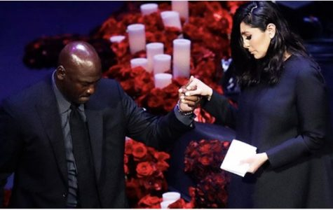 Vanessa Bryant and Shaquille O'Neal at Kobe Bryant's memorial. O'Neal helping Vanessa Bryant descend the stage. Photo courtesy of Google Images.