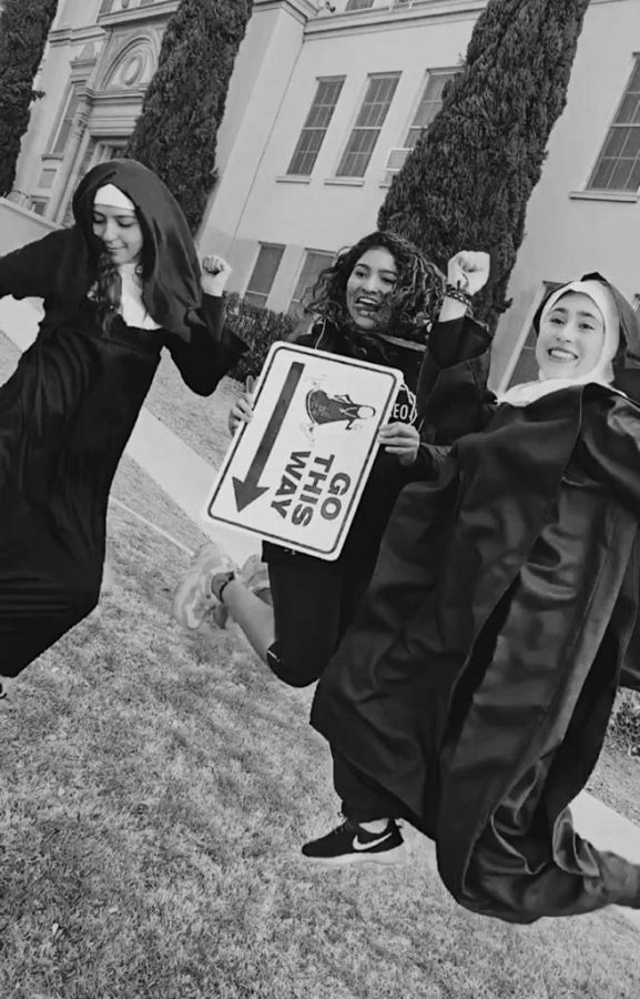 Seniors+Melissa+Hidalgo%2C+Renata+Gil%2C+and+Ximena+Zarate+preparing+to+guide+runners+as+they+take+on+the+annual+Nun+Run.+They+cheered+on+runners+while+dressed+as+nuns.+Photo+courtesy+of+Sophia+Navarro.%0A%0A