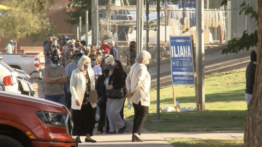 El Pasoans wait in the long lines of early voting. Early voting turnout has reported to be higher than in previous years.