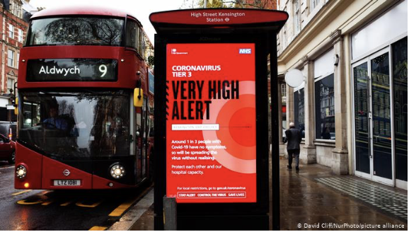 "With the UK on lockdown because of the new found COVID strain, the city of London is empty. On big bold letters the message of ""VERY HIGH ALERT"" telling civilians to stay home."