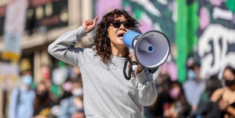 """Actress Sandra Oh speaks out at a Stop Asian Hate protest in Pittsburgh, Pennsylvania. Oh later led the crowd in a chant that yelled """"I am proud to be Asian."""""""